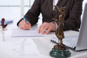 lawyer with lady justice figurine_72